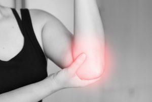 patiënt met tenniselleboog, potentiele klacht voor High Power Lasertherapie